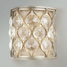 Hourglass and Crystal Drum Sconce - two or three of these staggered or stacked between the mirrors