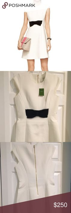 *Host Pick* Kate Spade Bow Dress NWT Kate Spade white dress with black front bow. NWT Never worn, perfect condition, brand new! Fitted dress, material is soft, and stretchy. This classic dress is great for work, a special occasion, or a night out. kate spade Dresses