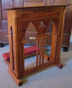 Custom mahogany prie dieu with gothic arches