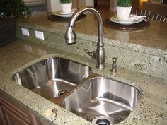 I like the undermount stainless double kitchen sink. Granite continues with backsplash and raised counter for eating. Multiple electrical outlets.