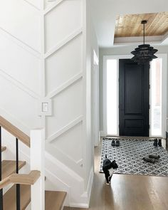 Love the beautiful woodwork, wall details, and our Kokoro pendant in this entryway🖤 Desig Home Decorators Rugs, Stairway Walls, Entry Way Design, House Siding, Room Paint Colors, Home Office Decor, Apartment Living, White Walls, Interior Architecture