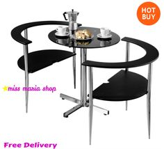 This is a stylish and space-saving dining set that fits neatly together. Includes a bistro table made from black glass and metal. Also includes two matching chairs crafted from MDF with black glass seat and back. Buy Dining Table, Round Dining Set, 3 Piece Dining Set, Small Dining, Kitchen Dining, Dining Room Furniture, Home Furniture, Accent Furniture, Luxury Furniture