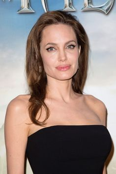 Celeb Makeunders That Blew Us Away #refinery29  http://www.refinery29.com/2014/05/68031/celebrity-makeunders#slide6  Angelina will always be our favorite vamp, but she's a little more subtle about it these days. The elements of her now-signature beauty look are glowing, almost-bare skin, a hint of eyeliner, and a swipe of lip balm.