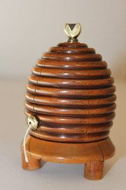 Small 19th century string holder in the form of a beehive. Beautifully turned in fruitwood, it has fine colour and patina. The brass and steel heart shaped cutter are part of the inner spool. The condition is good, all original there is some splitting in the wood.