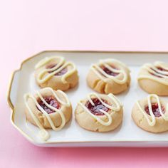 Raspberry-Lemon Thumbprint Cookies, only changes I made was leaving out the liqueur and using melted Lindt white chocolate truffles to drizzle.