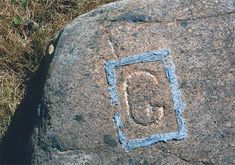 """Mystery on Oak Island The """"G Stone"""" was discovered in 1967 by Dan Blankenship near the Cave In Pit."""