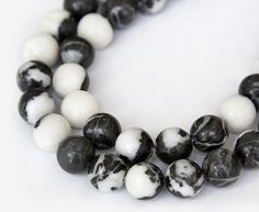 Mexican Zebra Jasper Beads, 10mm Round  Create a bold and unique statement piece with these round zebra jasper beads! They feature a unique pattern of grey, brown and cream yellow spots and stripes, hence the name.