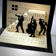 handmade pop-up card ... jazz theme with silhouettes of jazz musicians ... stairway to the stars? ... upcycled music score paper ... awesome card\!!