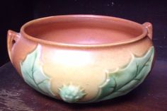 White Thornapple Blossom on one side with a Green Thornapple Spiked Bud on the other side. Roseville Pottery