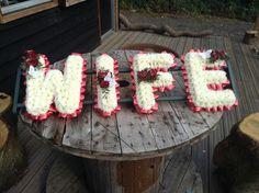 Funeral Flowers. Wife funeral flower tribute, letter funeral flowers red and white funeral flowers. www.thefloralartstudio.co.uk