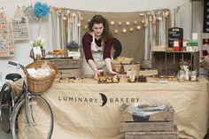 We loved the bakery set up! Cute bicycle and branding.