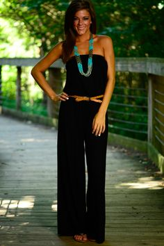 This sleek black jumpsuit is unbelievable! The super soft material and the elastic neckline and waistband gives you that perfect fit! Dress is up with heels or keep is casual with flats...either way look fabulous!