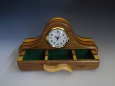 Work by Charles Buster, a member of the Craftsmen's Guild of Mississippi. This bandsaw box is made of walnut, cherry, yellowheart, and purpleheart. It a clock and a 3 compartment drawer that will make a great desk organizer for any desk.