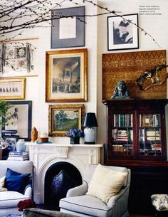 Love the round hearth...and stacked wall of pictures.
