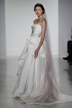 Peri- fit to flare silk organza ruched wedding dress with flounced layered skirt and raw edge trimmed detail