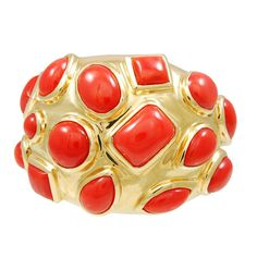 SEAMAN SCHEPPS . A beautifully bold dome ring made of 18k gold set with bright coral cabochons signed by Seaman Schepps. USA circa 1990s