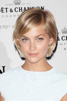 Whether you're growing your hair out or gradually chopping it off, Leigh Lezark's tiny bob is a great stepping stone in either direction. Plus, her deep side part adds an edgy element, and we love how it's pushed back toward her ears rather than in her face like most bobs. It works perfectly with her heart-shaped face. #refinery29 http://www.refinery29.com/52633#slide-3: