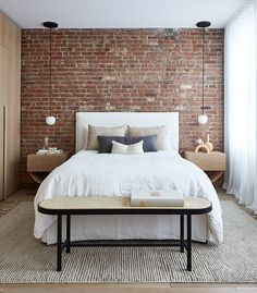 A SoHo loft apartment with exposed brick walls and a neutral color palette with subtle color touches Brick Wall Bedroom, Brick Accent Walls, Accent Wall Bedroom, Red Brick Walls, Exposed Brick Apartment, Exposed Brick Bedroom, Brick Wall Decor, Brick Wallpaper Bedroom, Soho Loft