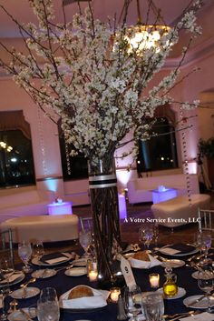 A white flower centerpiece with a hint of purple lighting.