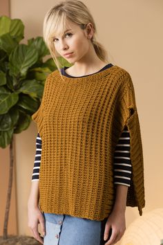 This poncho features a simple stitch pattern in a cotton yarn, which makes it wearable for many seasons.