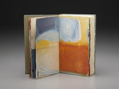 Jennifer Brook. Great way to get an art journal started - just colorblock it.