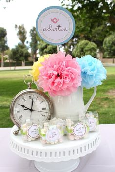 """Alice in Wonderland - Mad Hatter centerpiece inspiration. three different tiers like previously posted with three cups, a tea pot with flowers posted in them, and macaroons in little """"eat me"""" boxes."""