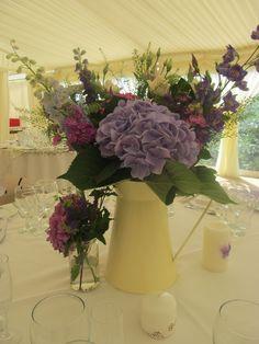 jug of country purple flowers