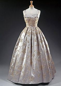 The Queen of England wore this grey satin gown embroidered with a fern motif in beads and pearls at a State Banquet held by President Eisenhower at the White House in 1957.