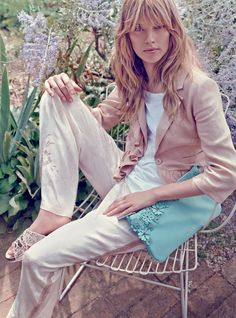 TWIN-SET Simona Barbieri: Frilly jacket and cotton T-shirt, palazzo pants, floral bag and sequinned sandals