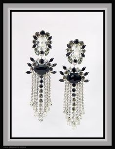 Very unique and confident design ideas make these waterfall shoulder dusters in Swarovski Crystal, Jet and Black Diamond stones - by Bryan Greenwood of Crystal Countess / Jewellery by Greenwood Design