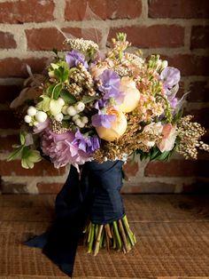 {Beautiful bouquet by Out of the Garden}, Charleston, Charleston Wedding, South Carolina, Southern Weddings, Chandelier, flowers, roaring twenties, 1920's wedding, vintage, table, Wedding Planner, bouquet, floral, wedding flowers, navy blue, purple, peach, peonies