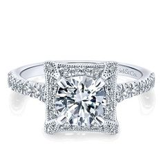 Antique Halo Diamond Ring available at Emma Parker & Co.