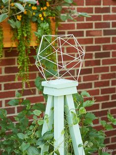 Obelisks -- built from 2x2s -- add height to a garden. Miter the post ends at 7-degree angles to achieve a trapezoidal shape with a square base. Top the structure with a cap made from scraps.