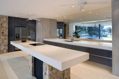 A lovely island kitchen with a mirrored backsplash so that the view can be enjoyed even when your back is turned to the windows. Fans help keep the air circulating on hot days.