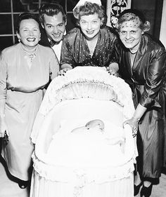 Lucille Ball and Desi Arnaz with their newborn daughter Lucie Arnaz. and their mothers DeDe, and Dolores.