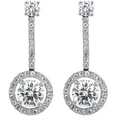 Tiffany & Co. 1.85 Carat Diamond Drop Estate Earrings. 18 karat white gold diamond drop earrings consisting of 2 round brilliant cut diamonds with a straight line of diamonds to 2 round brilliant cut diamonds, having an approximate weight of 1.85 carats, surrounded by a single row diamond halo with an approximate color/clarity of F-G/VS2 signed Tiffany & Co.