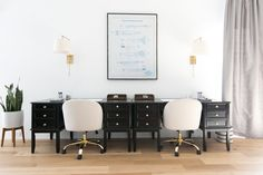 Symmetrical desks with modern, luxe chairs and white and gold sconces make for a sophisticated workspace!