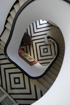 Staircase with patterned floor - beautiful design and brilliant photography