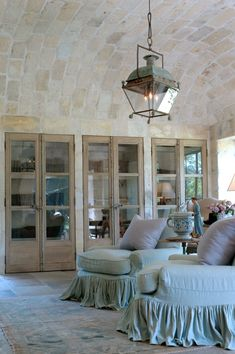 Three pairs of century French doors, barrel vaulted ceiling clad in century stone from a French Vineyard. Chateau Domingue Timeless European Elegance and French farmhouse style in Ruth Gay's exquisite home. See more Gorgeous Sources for European Country French Farmhouse Decor, French Country Living Room, French Home Decor, French Country Cottage, Farmhouse Interior, French Country Decorating, Farmhouse Design, Home Interior, Interior Doors