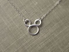 Mickey Mouse Necklace Sterling Silver Disney Fan Flower girl gift Disney Weddings. $22.00, via Etsy.