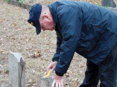 Paul Mattoon cleaning a headstone