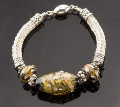 Lampwork bead & viking knit bracelet.