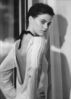 I love how this low back sweater looks untied and accentuated with a black bow choker.