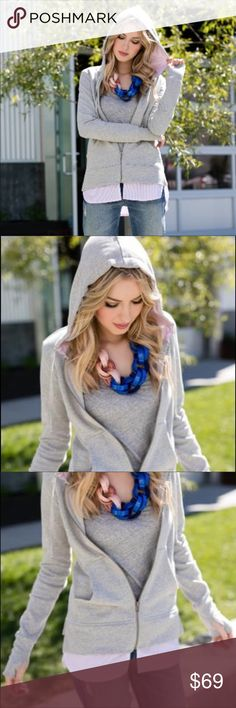 Evy's Tree Bryony Luxury Zip up Sweater The Bryony features acozy 100% cotton, french terry zip up hoodie in heathered grey, a cotton candy striped poplin cotton attached at the hem and inside the hood to give the appearance of a button up shirt under the hoodie.  Thumbholes and cozy pockets.  The layered look makes it the perfect item to wear over leggings or skinny jeans. The best spring/summer instant dress up! Evy's Tree Tops Sweatshirts & Hoodies