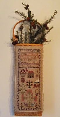 Lovely finishing work and display   http://samplers-and-santas.blogspot.com/p/stitchers-christmas.html