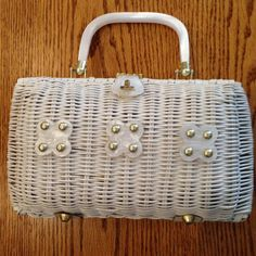 Hey, I found this really awesome Etsy listing at https://www.etsy.com/listing/194734853/sale-white-woven-wicker-handbag-vintage