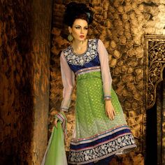 Shaded Pista Green and Off White Net and Viscose Churidar Kameez