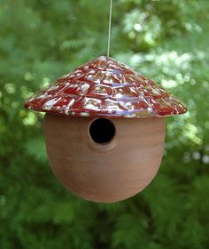 Unique gourd bird house is original art thrown on a potters wheel with unusual vibrant glazes.