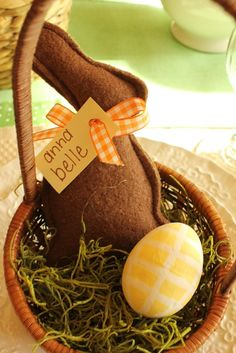 Felt chocolate bunny. Lambs would be cute too. Cute gift basket idea.