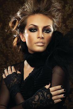 Black eyeshadow and nude lipstick
